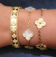 Van Cleef and Arpels bracelets; diamonds, mother-of-pearl & gold. Alhambra collection. Definitely on my Wish List.