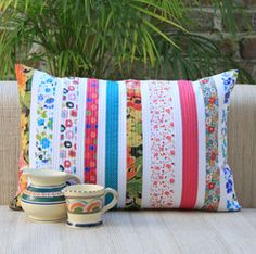 quilted pillow __could do this with low contrast strips and decorative stitching or a more subtle look