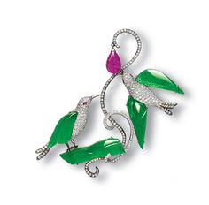 Designed as pavé-set diamond birds, enhanced by carved jadeite feathers of brilliant emerald green colour and very good translucency, with cabochon ruby eyes, one bird perched on a carved jadeite branch, mounted in 18k white gold and oxidised gold, 7 cm long