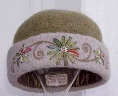 Embroidered and embellished knitted-felt hat by Carrie Cahill Mulligan.