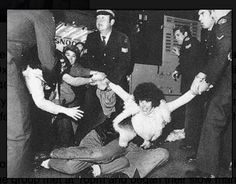 Robyn Plaister being arrested 1978 first Sydney Mardi Gras. Shearling coats have made a come back.