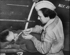 MILITARY NURSE, KOREAN WAR  Like in World War II, women nurses were set up to work in combat zones. Throughout World War II and the Korean War, many women were taken as prisoners of war and many sustained casualties from enemy fire. Here, a nurse aids a victim of the Korean War.