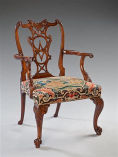An elegant George II carved mahogany armchair.