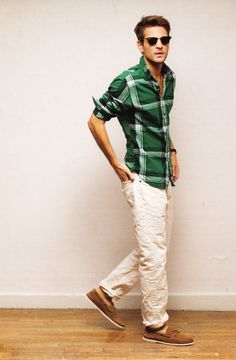 Green plaid with white pants ans brown shoes