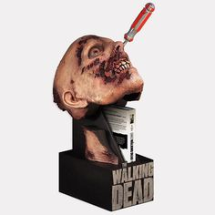 I love this show but think this figure would be too disturbing to have in the tv room.  The Walking Dead DVD packaging