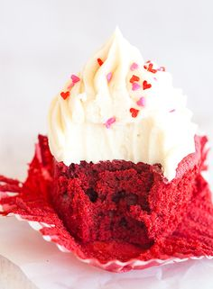 The BEST red velvet cupcakes - a gorgeous red color, moist and fluffy, and topped with luscious cream cheese frosting.