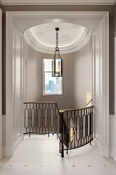 Iron banister. Carriage light. Moulding. Wall color. Light through window. What else?