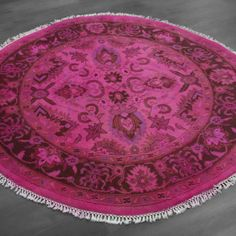 round overdyed rug hot pink