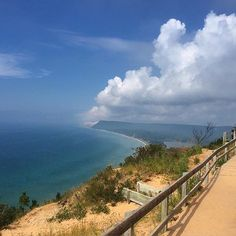 What a view! We couldn't help but share this shot of Empire Bluff overlooking Lake Michigan captured by @Michelle1439. Thanks for sharing! #PureMichigan #SleepingBearDunes