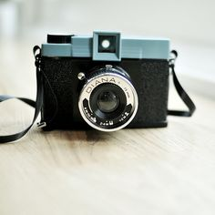 love old cameras. I've seen a variety at Urban Outfitters.