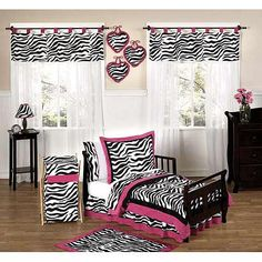 The Zebra Print 5-piece toddler bedding ensemble by JoJo Designs will set your child's room up in high style. This funky and modern animal print bedding set uses a collection of soft Micro suede fabrics including light pink, hot pink, and a striking black and white zebra print. This fashionable girl bedding set features a super contemporary look using a stunning color combination. This set will fit all standard toddler beds and is machine washable for easy care and repeated use.<br><br>The…