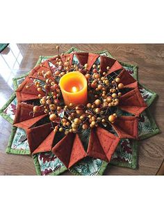 Stitch up some seasonal cheer!   Need a pretty seasonal wreath or a unique table topper? Grab some fabric and the pre-cut stabilizer below and whip up this dimensional design in just an afternoon and you'll have a one-of-a-kind look to show off to al...