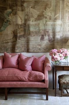 Love the softness of the wall hanging and the pop of colored pillows on the sofa - and those beautiful flowers of course!   via ZsaZsa Bellagio