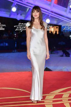 dc65a46aa3cd Dakota Johnson in a slinky cream scoop neck slip dress by the Ukraine-based  label
