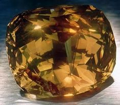 "The Golden Jubilee is the largest faceted diamond in the world, weighing 545.67 carats. Cutter Gabi Tolkowsky describes the cut as a ""fire rose cushion cut."" The color has been graded as fancy yellow-brown."
