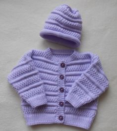 Here I worked a super cute garnish in a beautiful lilac color. The jacket and hat are part of the set. I would like shoes at an additional cost of € . Here I have a super cute set in a beautiful lilac tone . Baby Knitting Patterns, Baby Cardigan Knitting Pattern, Baby Hats Knitting, Kids Patterns, Knitting For Kids, Knitting For Beginners, Knitting Stitches, Knitted Hats, Baby Boy Sweater