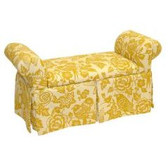 """Skirted storage bench with rolled arms and a pine wood frame. Handmade in the USA.        Product: Storage bench   Construction Material: Wood and fabric   Color: Canary maize     Features:     Ample storage space  Elegant addition at the foot of a bed or in the living room        Dimensions: 27"""" H x 51"""" W x 19"""" D          Cleaning and Care: Spot clean"""