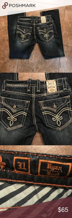 Rock Revival Boot (Ryan) Jeans 31x33 Rock Revival Jeans. Barely worn if even ever. Boot cut: bottom is barely frayed which I think hey actually came that way. Excellent condition and great color. Jeans Bootcut
