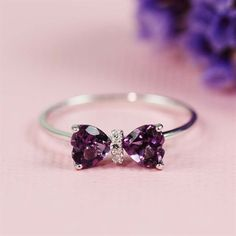 This beautiful ring features two heart shaped amethysts. This ring is set in sterling sterling silver.    Material: sterling silver,