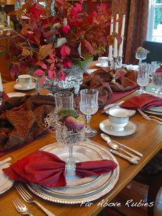 beautiful foliage in old silver (http://anita-faraboverubies.blogspot.com/2012/09/autumn-tablescapes.html)