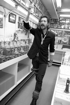 "fudagraphy: "" Eugene Hütz at Honest Eds from a few years back. I was going through my files and found this one amusing. He pretty much hated every idea I had and just ran around Honest Eds like a maniac while I photographed him. I found out after..."