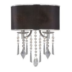 Chromed wall sconce with crystal accents.    Product: Wall sconce    Construction Material: Crystal, fabric and metal