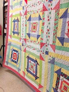 nested churn dash quilt along - like this setting. colored sashing strip with different colored corner stone to have secondary block appear.