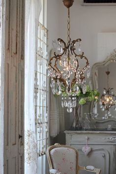 Vintage French Soul ~ Rustic and refined. I love the iron and crystal combination here.
