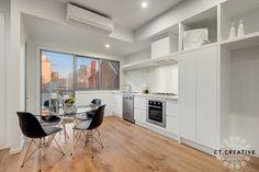 Black Eames chairs with white kitchen. Photography by CT Creative. Black Eames Chair, Eames Chairs, Real Estate Photography, Kitchen Black, Living Room, Creative, Melbourne, Table, Kitchens