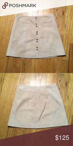 """Intermix Suede Leather Skirt sz L Super 70's Intermix Suede Mini Skirt with fitted silhouette, dual pockets at front, panel stitching throughout and silver-tone snap closures at front. sz L.  Item is a sandy beige a little bit warmer than what is photographed in last 2.  images.  Waist: 32"""" Hip: 42"""" Length: 17"""" Intermix Skirts Mini"""
