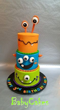 Colorful cute monster mini tiered birthday cake.