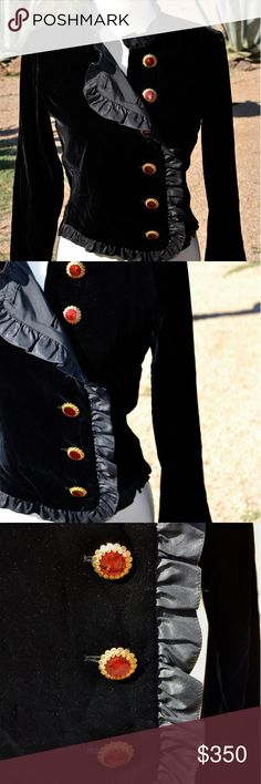 """Vtg Blk Silk Velvet YSL Yves Saint Laurent Blazer GORGEOUS VINTAGE BLACK VELVET YSL BLAZER.  ADORNED WITH HEAVY GOLD DETAILED BUTTONS WITH A RED ENAMEL.  RUFFLE DETAILING AT ALL EDGING OF THIS PIECE.  IN BEAUTIFUL COMPLETELY WEARABLE CONDITION.  NO STAINS OR FLAWS TO NOTE. MATERIAL IS 100% SILK LINED AND VISCOSE SILK VELVET.  SUPER LUXURIOUS AND SOFT.  MARKED A SIZE 36, TRANSLATES TO A U.S. SMALL.  MEASURES UNDERARM TO UNDERARM BUTTONED/FLAT 18'', SHOULDER TO BOTTOM HEM 20"""", SHOULDER TO END…"""