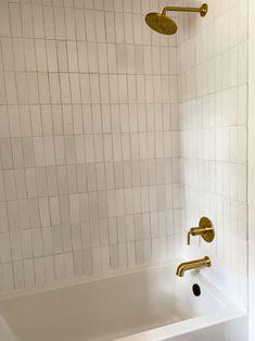 Girl & Grey White Bathroom Tiles | Fireclay Tile | Fireclay Tile Gray And White Bathroom, White Bathroom Tiles, Bathroom Floor Tiles, Glass Shower Doors, Shower Faucet, Shower Tub, Shower Walls, Gray Shower Tile, White Shower