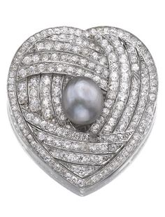 An Art Deco pearl and diamond clip, 1920s. The heart-shaped clip set with rose, single- and circular-cut and cushion-shaped diamonds, embellished at the centre with a pearl of grey tint, mounted in platinum. #ArtDeco #clip