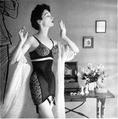 I love old photos like this!!! The women always look so classy, even if they are in their under garments! Lol