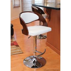 The Cary Adjustable Swivel Bar Stool has a unique design that makes it ideal for homes that have modern interiors.It has a frame that is made of metal to ensure sturdiness and durability. The faux leather seat and padded back makes for a comfortable seating experience. The Cary Adjustable Swivel Bar Stool has a maximum weight capacity of 250 pounds. It can swivel 360 degrees completely and its height can be adjusted to suit your needs. Stylishly designed, it features a zebra wood frame that…