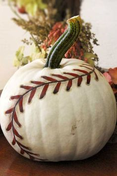 Painted Baseball Pumpkin: This cool and creative pumpkin is a guaranteed home run. Click through to find more easy painted pumpkin ideas to try this Halloween. (Cool Halloween Games)