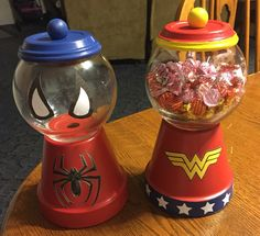 Spider-Man and Wonder Woman Candy Bowls made with terra cotta pottery, paint, and a Cricut Explorer.