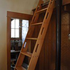 This ladder can be hung on a wall when not in use!  Big plus!