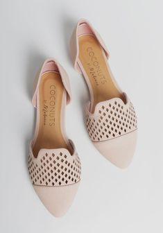 Crafted in a gorgeous light pink hue, these soft faux leather flats feature a classic d'orsay design with pointed toes and diamond-shaped laser cutouts.