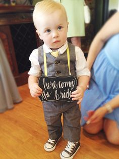 Dapper toddler + Cute Sign = Sweetest Ring Bearer Ever! | Featured on 20somethingbeautiful.com