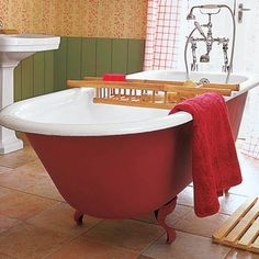 Make your cast-iron tub a focal point by  coloring the outside a vibrant hue.  For a shade similar to shown, try All Surface Enamel in Rave Red, $44 per gallon; sherwinwilliams.com