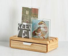 Stash your favorite keepsakes and display your favorite photos in the same unit. This wooden box features a velvet lined drawer, and can hold up to 3 photos on its slotted top. Includes 3 glass frames.