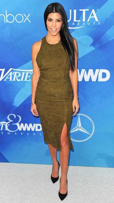 Kourtney Kardashian in an Alice + Olivia olive green suede body con top and skirt