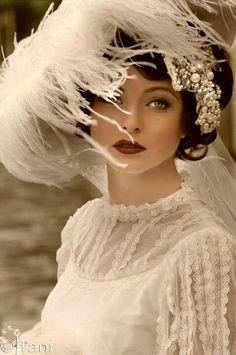 a stunner in an ostrich feather hat...