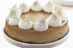 Cappucino Cheesecake.A walnut crust encases a creamy coffee cheesecake flavored with a hint of cinnamon in this cappuccino-like treat.