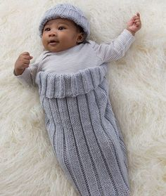 Comfy Knit Baby Cocoon and Cap - Your baby will be both adorable and cozy in this comfy knit baby cocoon and cap. The rib knit matching set is sure to keep any bundle of joy warm, but be warned that you won't be able to put the camera away after seeing all the cuteness. This is an easy knitting pattern that uses circular and double pointed knitting needles and one skein of fabric. The neutral color would fit both genders.