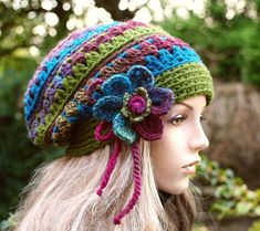 Like this hat- not really the colours, love the flower, but not the strings hanging down.