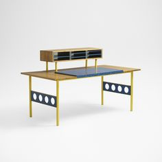 Lot 173: Alessandro Mendini, attribution. desk. c. 1970, birch, laminate, enameled steel, painted wood. 66¾ w × 33 d × 39 h in. result: $5,625. estimate: $5,000–7,000. Desk features three compartments housing five adjustable shelves.