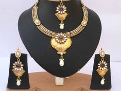 Gorgeous fashion gold plated imitation pearls and clear cubic zirconia stones polki set-03plk201  http://www.craftandjewel.com/servlet/the-1431/Gorgeous-fashion-gold-plated/Detail